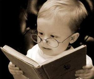 kid with glasses reading