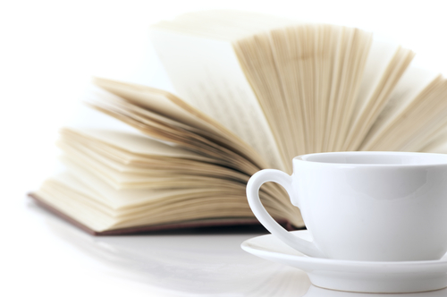 shutterstock_77718817 White cup of coffee and open book on white background